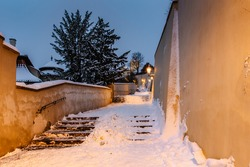 Old Castle Stairs at night, Prague, Czech Republic.Beautiful spectacular winter panorama of Vltava river and historical buildings.Romantic way up from Lesser Town to Prague Castle.Snowy cityscape