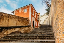 Old Castle Stairs on sunny day, Prague, Czech Republic.Beautiful spectacular panorama of historical buildings.Romantic way up from Lesser Town to Prague Castle.European cityscape.Urban background