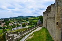 Old castle with high towers, historical fortress with walls and moat, knight's castle of king and queen