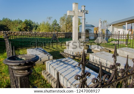 old catholic cemetery. beautiful granite crosses and tombstones against a clear blue sky. #1247008927