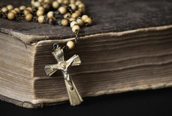 Old Catholic rosary and tattered Bible detail
