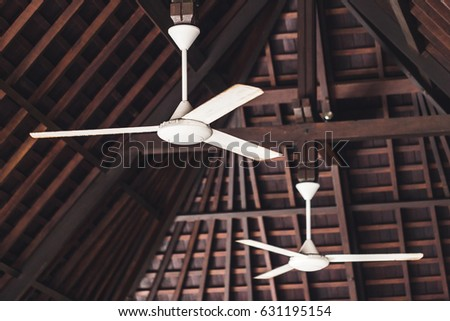Free photos tropical wooden colonial style ceiling fan avopix old ceiling fan hanging under wooden roof asian style 631195154 aloadofball Choice Image