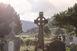 Old Celtic Cross in The Glendalough s Cemetery. Wicklow mountain, Ireland