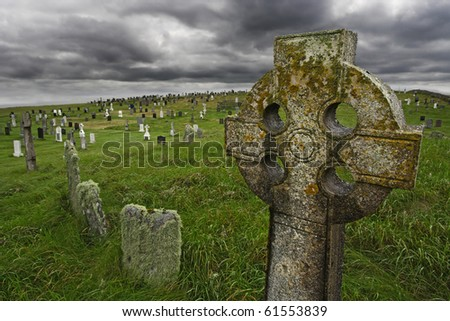 Old Celtic gravesite with unmarked gravestones from the 1600's in the middle of a meadow in rural Scotland.