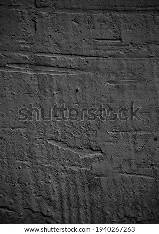 Old cement wall texture dark black gray background. Stone wall. Grungy concrete texture background. Cement background with gray wall texture. Cracked wall background Foto stock ©