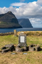 Old cemetery at Vidareidis village on the Island Vidoy in the Faroe Islands. The stone church was built in 1891-1892