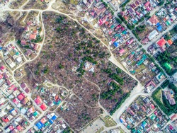 Old cemetery in the city of Gelendzhik. The view from the top. Orthodox Church in the center of the cemetery. There are residential buildings around the cemetery..