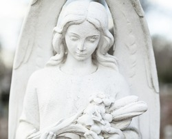 Old cemetery sculpture of the young girl.