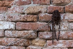 Old chain tied to the wall