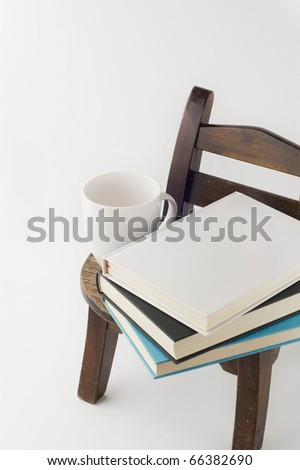 old chair and books and cup