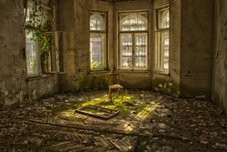 Old chair in an abandoned dilapidated house