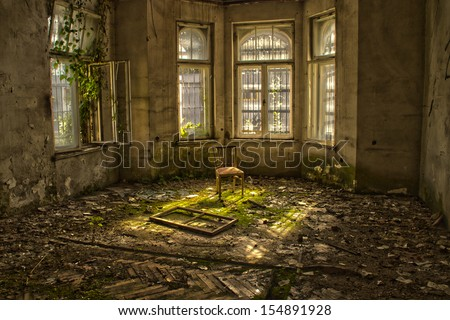 Old chair in an abandoned dilapidated house #154891928