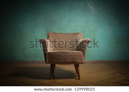 Old chair in grunge room with green wall
