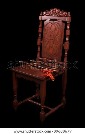 Old chair with medieval wood winds - stock photo