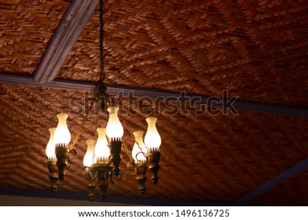 old chandelier lit in rustic home interior at Minas Gerais
