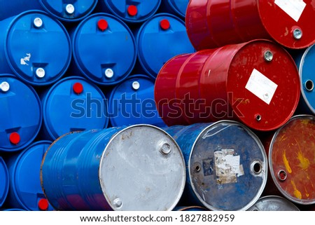 Old chemical barrels. Blue and red oil drum. Steel and plastic oil tank. Toxic waste warehouse. Hazard chemical barrel with warning label. Industrial waste in drum. Hazard waste storage in factory.  Zdjęcia stock ©