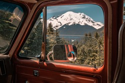 old chevy van sitting in front of mt rainier