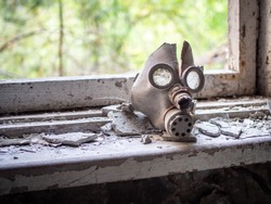 Old children's gas mask inside of the abandoned Pripyat Elementary School No. 3 in Pripyat city, Chernobyl Exclusion Zone, Ukraine