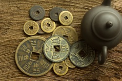 old chinese coin on tea table