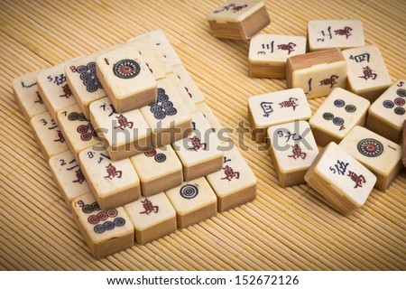 old chinese game mahjongg on bamboo mat background ez canvas