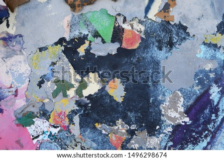 Old chipping colourful weathered graffiti wall background texture