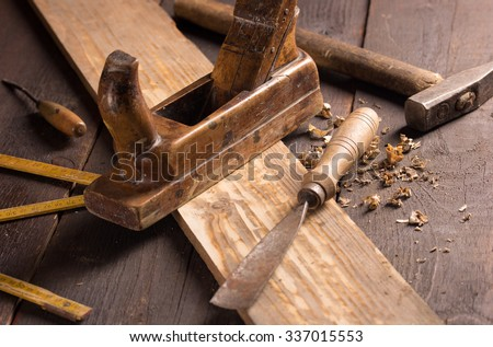 Old chisel and planer in a carpentry workshop