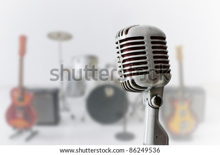 Old Chrome microphone and Blur musical instrument background