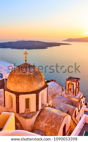 Old church in Thira town and Aegean sea at sundown, Santorini, Greece