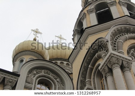 Old church in Vilnius, Lithuania. Layered picture with three of the churches tower all equiped with golden crosses.