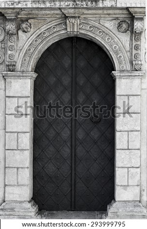 old church textured door with stone arch facade