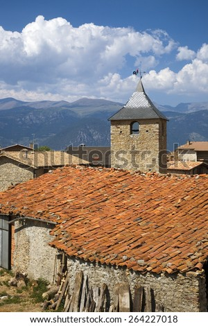 Old church tower in Cal Rill medieval village in Pyrenees Mountains, near La Seu d'Urgell, Cataluna, and Ansovell, province of Lleida, off N-260 Road, Spain, Europe Stock fotó ©