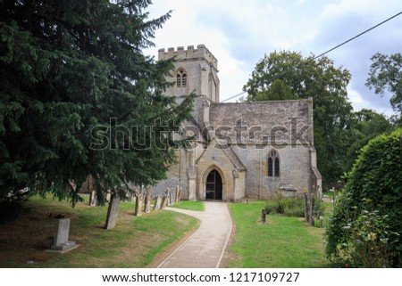 Old church with crenelated tower in English countryside