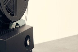 Old cinema 8mm film roll and projector close-up. Cinematic concept