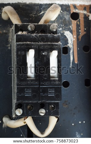 Old circuit breaker in the electrical panel #758873023