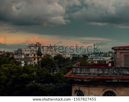 Old city view with dramatic / moody clouds #1507827455