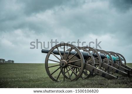Old Civil War cannon line prepared for battle #1500106820