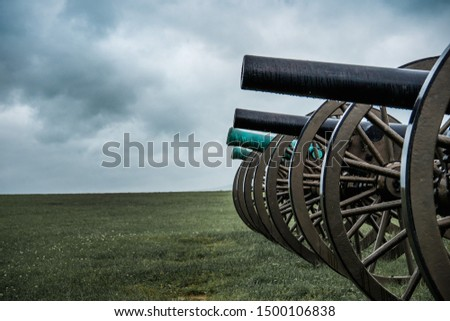 Old Civil War cannon line prepared for battle #1500106838