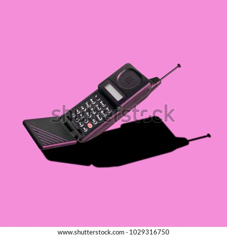 Old classic analog mobile phone nostalgia in punchy color, with aerial and microphone flip, for creative design cover, CD, poster, book, printing, gift card, flyer, magazine web & print