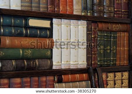 Old classic books on bookshelf