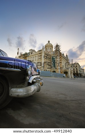Old classic car parked in front of Revolution Palace building in Havana, cuba