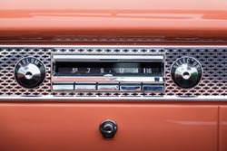 Old classic car radio in the dashboard