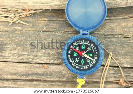 Old classic navigation compass on natural background as symbol of tourism with compass, travel with compass and outdoor activities with compass