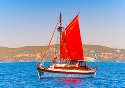 Old classic wooden Greek boat (Kaiki) with sails during a Classic Boats Regatta in Spetses island in Greece