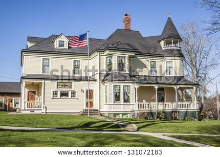 old classical American building with blue sky on background