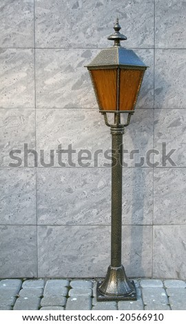 Old classical lantern standing on the ground