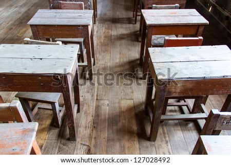 Old classroom ,wood chair and desk - stock photo