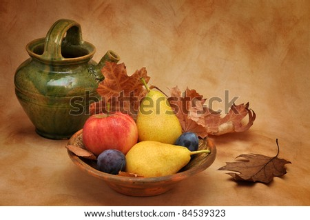 Old clay bowl full of autumn fruit