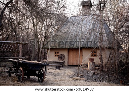 Old clay house with wooden roof