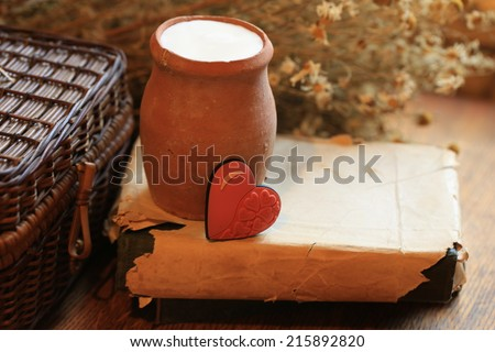 http://www.shutterstock.com/ru/pic-215892820/stock-photo-old-clay-jug-of-milk-dry-food-health-daisy-flowers-book-heart-love-romantic-valentine-breakfast.html?src=jbJfCWTgnY9_1XyC6aDsVA-1-12