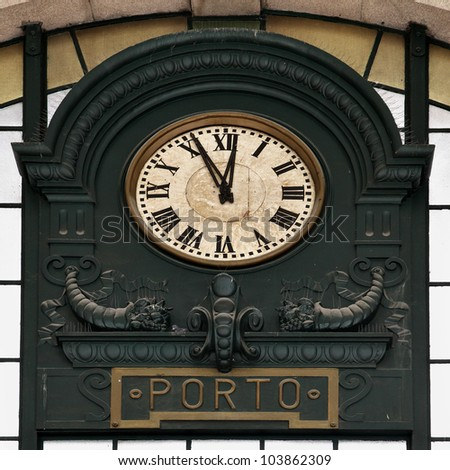 Old clock at railway station in Porto